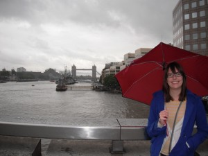 Me on the London Bridge, with Tower Bridge behind me. Umbrella too, 'cause it's London.